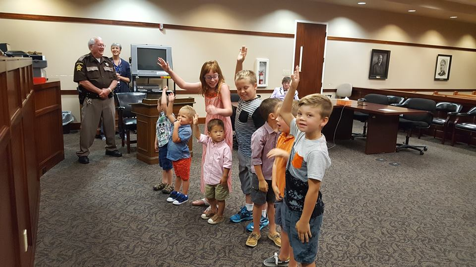 Kids raising hands at adoption day
