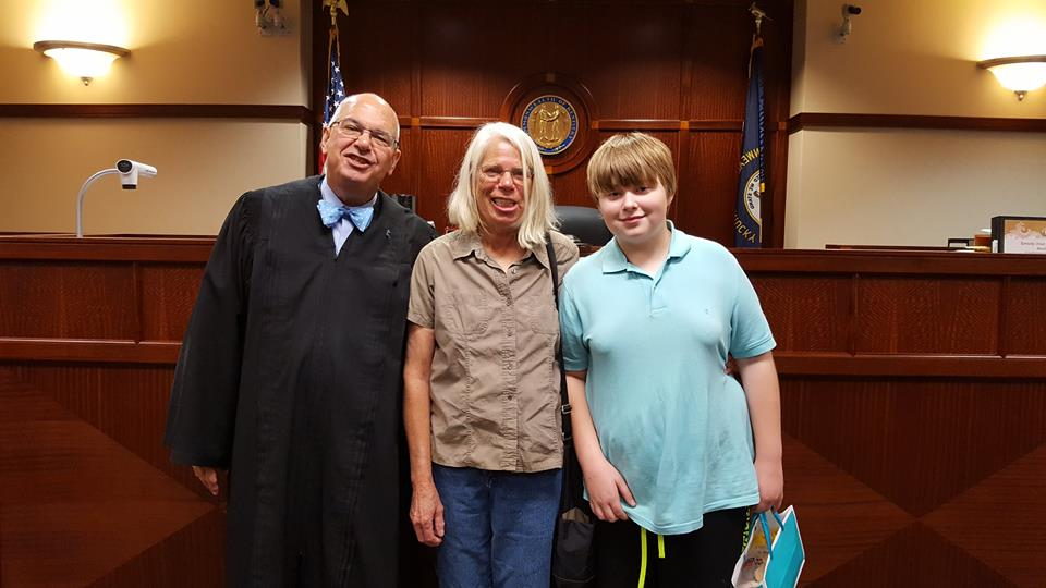 Family and judge at adoption day