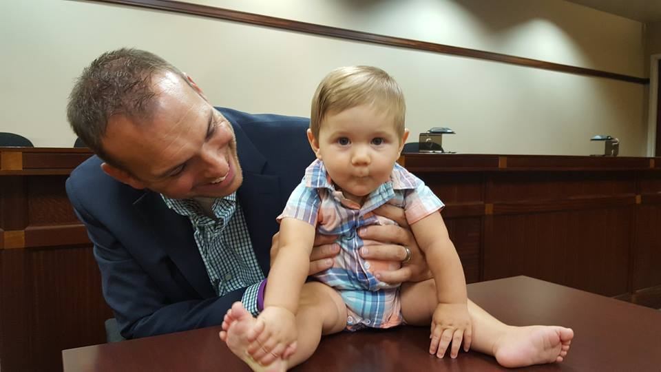Baby and father at adoption day