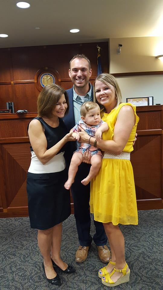Family at adoption day standing with Susanne Cetrulo